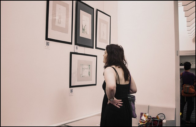 The artist Paola Guerra during her exhibition in Florence